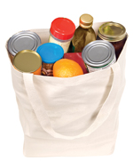 Reusable canvas bag filled with groceries on white background.